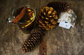 pic of christmas spices  - Christmas time cup of tea with cinnamon and anise spices festive decoration and candles - JPG