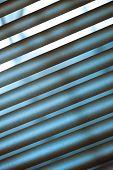 foto of jalousie  - Metal jalousie background in blue toning in closeup - JPG