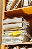 image of stelles  - Stell office bookcase with stack of paper - JPG