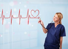 foto of beating-heart  - Beautiful young nurse listening to abstract pulse with red heart - JPG