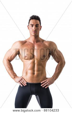 Frontal shot of shirtless muscular young man
