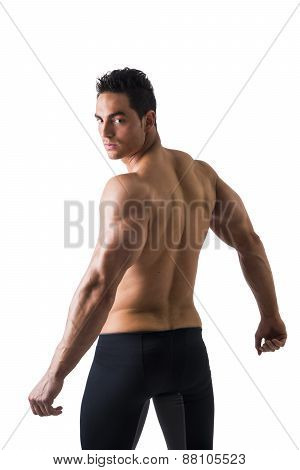 Back shot of shirtless muscular young man, relaxed