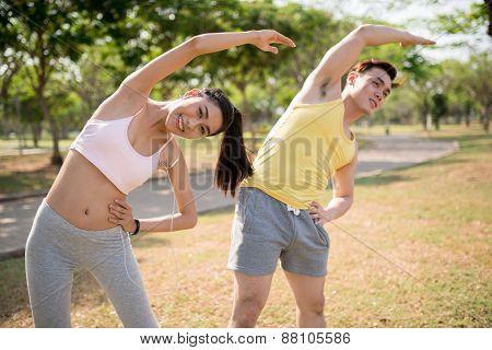 Doing back stretching exercise