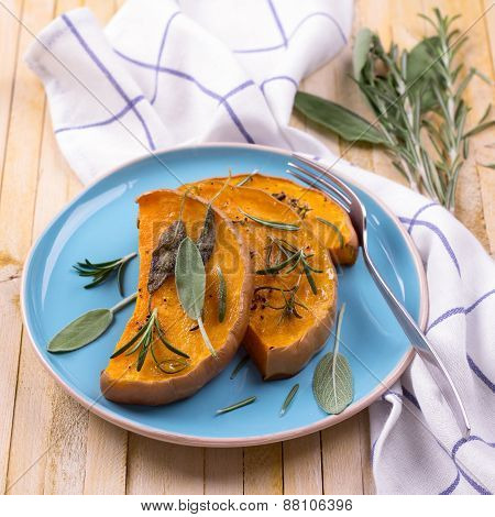 Baked pumpkin with herbs and spices