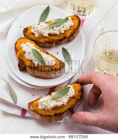 Bruschetta with pumpkin puree, ricotta and sage