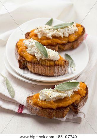 Bruschetta with pumpkin puree, ricotta and sage