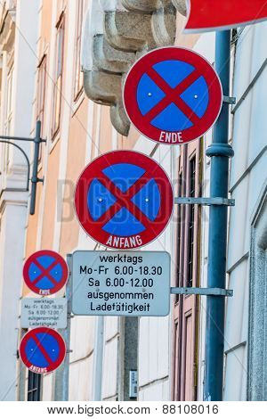 signs stopping downtown, symbol of prohibition, parking space, delivery vehicles