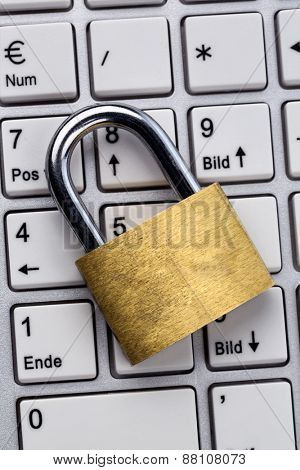 a padlock on a computer keyboard. symbolic photo for data security and hacking