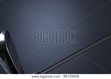Golf club isolated on dark blue background, blank copy space for text.