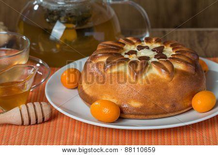 Pie With Tea On Orange Background