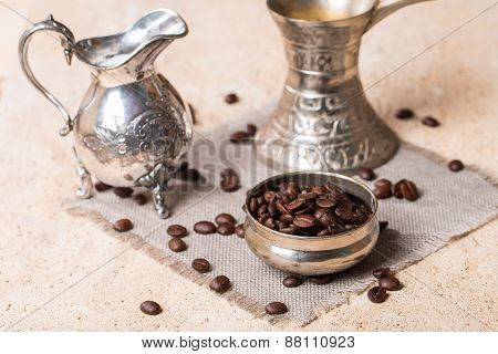 Coffee Beans In Bowl Milk Jug And Coffee Pot