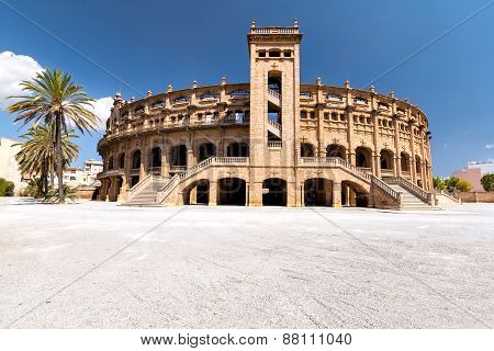 Panorama building for bullfighting in Mallorca on a sunny day.