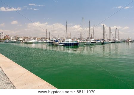 Sailing yachts and boats are in the harbor Palma de Mallorca.