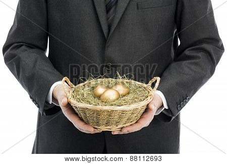 Businessman Holding Basket With Golden Eggs
