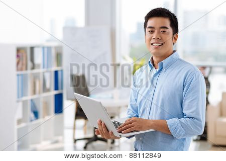 Vietnamese manager with laptop