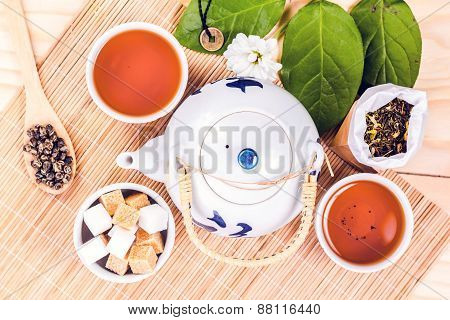 asian tea set on wooden table, top view