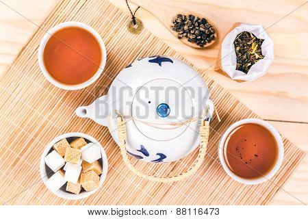 asian tea set on wooden table, view from above