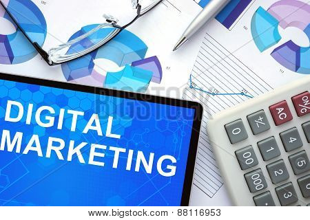 Tablet with Digital Marketing, graphs and calculator.