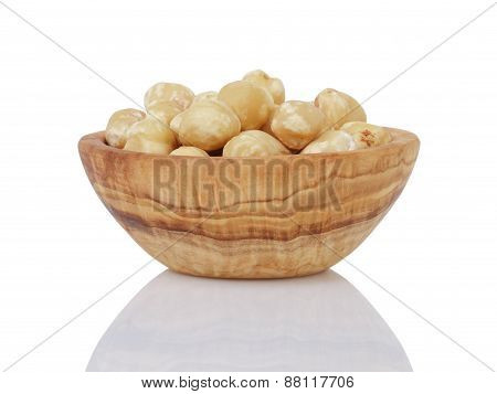heap of peeled hazelnuts in bowl isolated