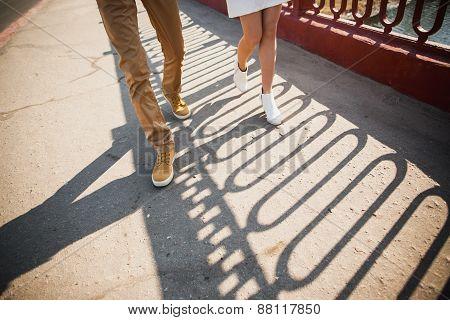 Woman And Man Walking Along Street