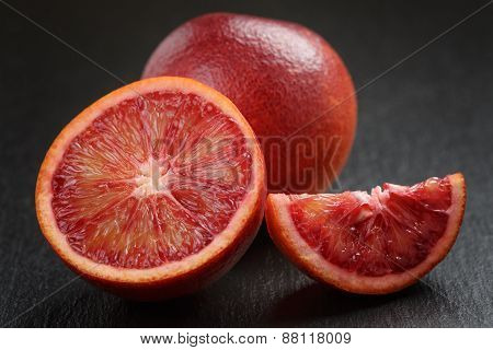red sicilian oranges sliced on slate board