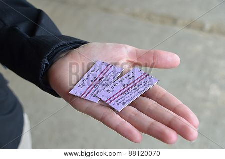 Two Train Tickets In Hand Of A Girl