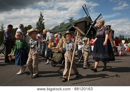 BURG, GERMANY - AUGUST 28, 2011: People attend the Sorbian harvest festival in the Lusatian village of Burg in Spreewald Region, Lower Lusatia, Brandenburg, Germany.