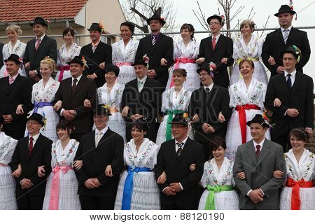 TURNOW, GERMANY - MARCH 13, 2011: Young people in Sorbian costumes attend the Zapust Carnival in the Lusatian village of Turnow near Cottbus, Lower Lusatia, Brandenburg, Germany.