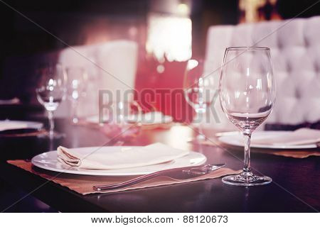 Place setting in a restaurant, shallow focus, toned image