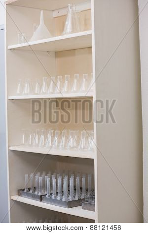 Storage unit with test tubes and beakers in laboratory