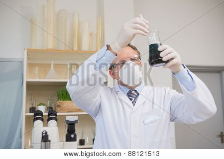 Scientist doing experimentations in flask in the laboratory