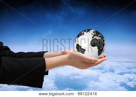 Businesswomans hands presenting against white clouds under blue sky