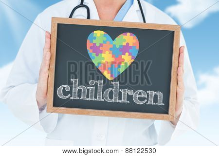 The word children and doctor showing chalkboard against blue sky