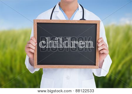 The word children and doctor showing little blackboard against green meadow