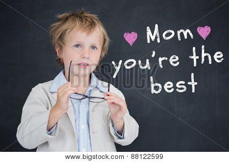 Cute pupil holding glasses against black background