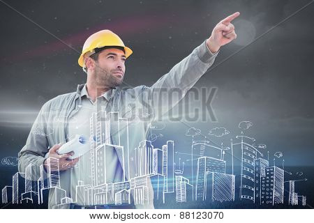 Architect pointing against green field at night