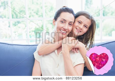 heart against mother and daughter smiling at camera
