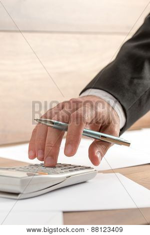 Businessman Doing A Calculation