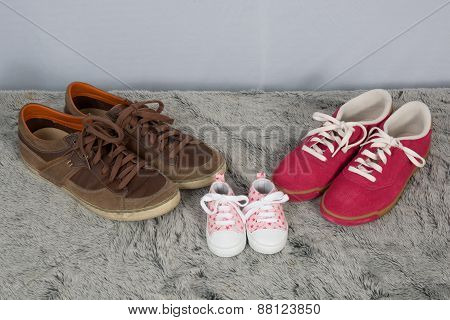 Parent And New Born Child Shoes On The Floor