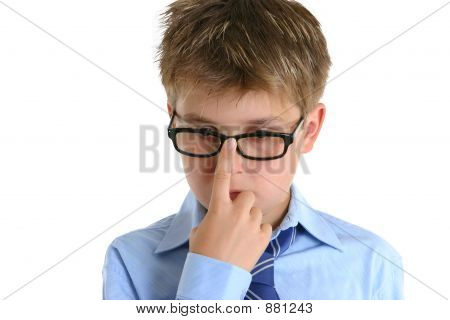 Child Pushing Glasses Up Onto Nose