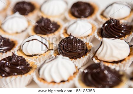 white and black meringue cookies.
