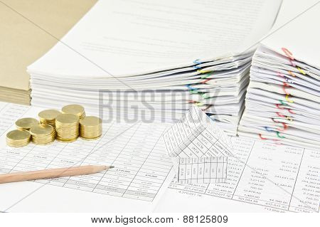 Brown Pencil And Gold Coins With House On Finance Account