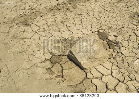Land And Stone With Dry And Cracked Ground. Desert