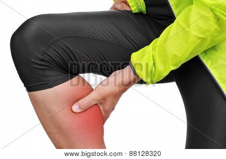 closeup of a young caucasian sportsman wearing sport clothes with his hand in his calf because of his calf muscle pain