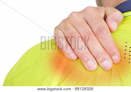 closeup of a young caucasian sportsman wearing sport clothes with his hand in his back because of his backache