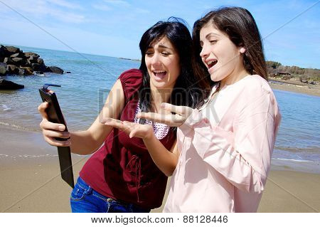 Two Girlfriends Looking At Selfie They Have Done Unhappy