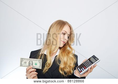 Attractive business woman, wearing a suit and shirt.