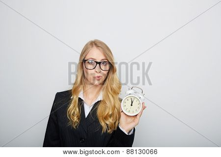 Full isolated portrait of a beautiful caucasian businesswoman locking at the clock. highnoon