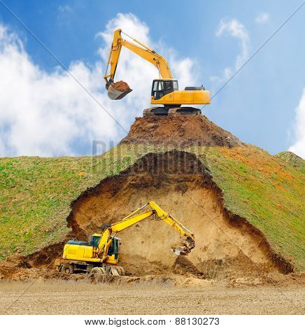 Excavators digging big hole.