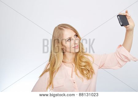 girl with a smart phone. isolated on white.